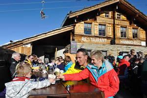 Family in the mountain restaurant Hannighüsli