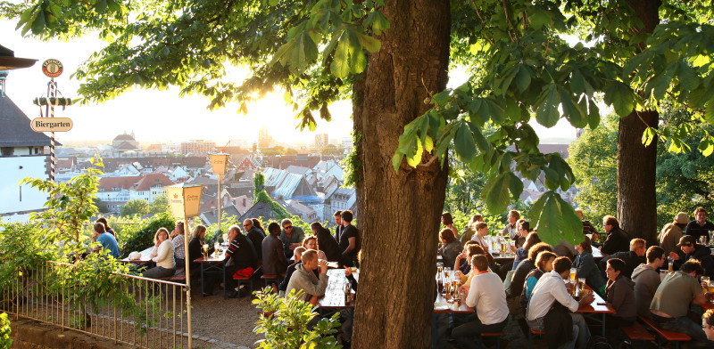 Beer garden Kastaniengarten Freiburg with great view over the city © Greiffenegg Schlössle